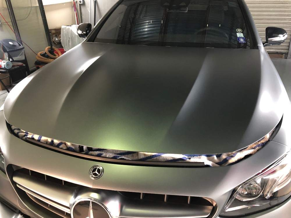 Grey Mercedes uncovered with fresh paint