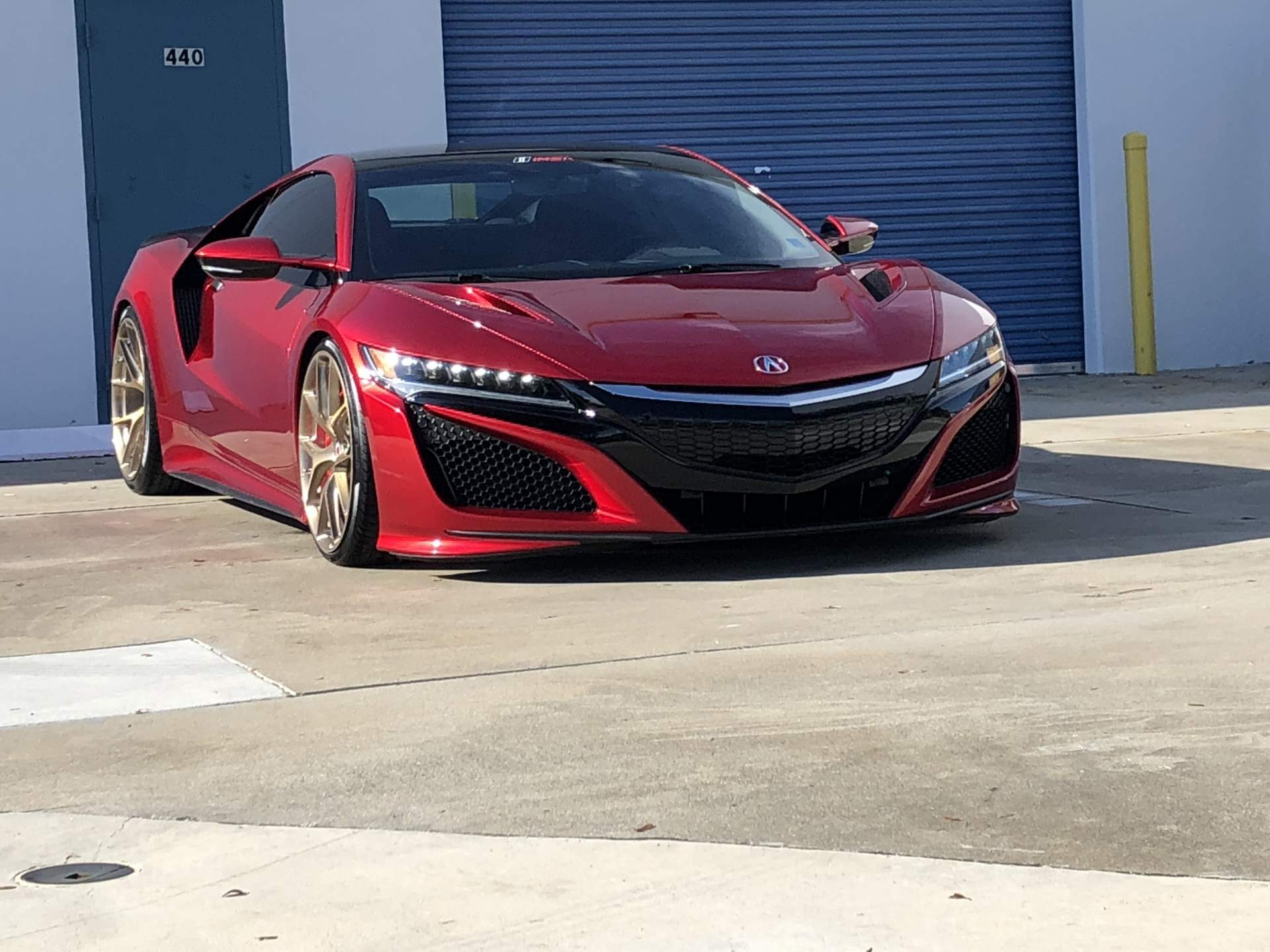 Red Honda NSX shined up shown diagonally