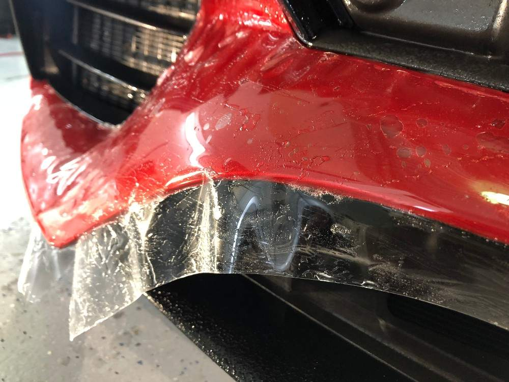 Red bumper covered in plastic